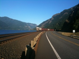 It is no coincidence that the railroad and road are located along the Columbia River. The flat, rock-free land lends itself readily to transportation development. Photo courtesy of John Russell.